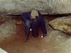 Пилигрим на выходе из Кошачьего лаза. Пещера Помойка. 2000 год.